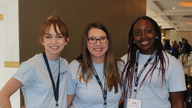 three college students at CASE ASAP conference